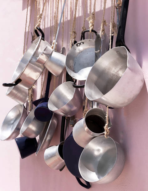 Pots And Pans . Isolated on a Pink Background stock photo