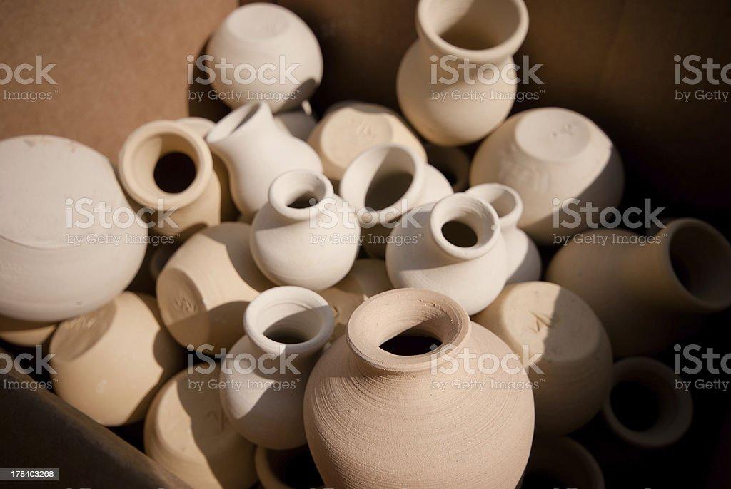 pots before firing stock photo