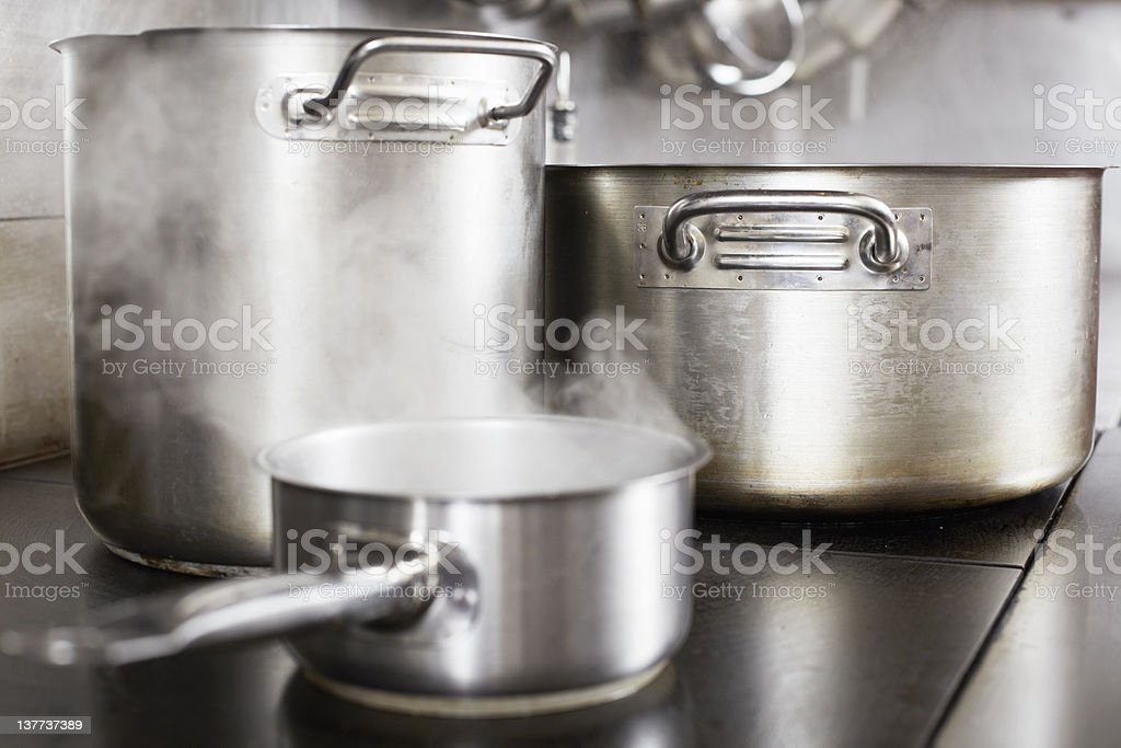 Pots boiling on stove stock photo