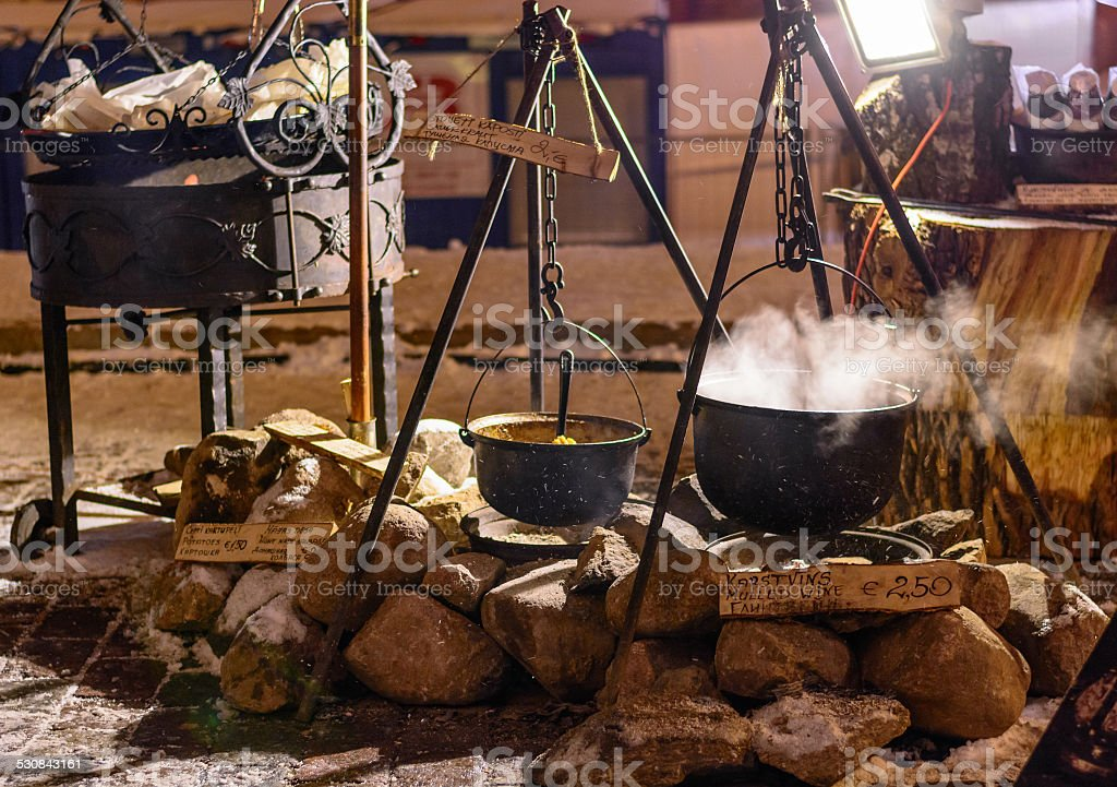 Pots of hot wine and soup at traditional Christmas night stock photo