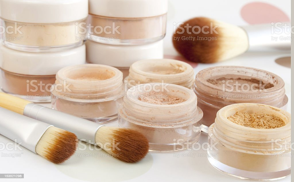Pots of make up with cosmetic brushes stock photo