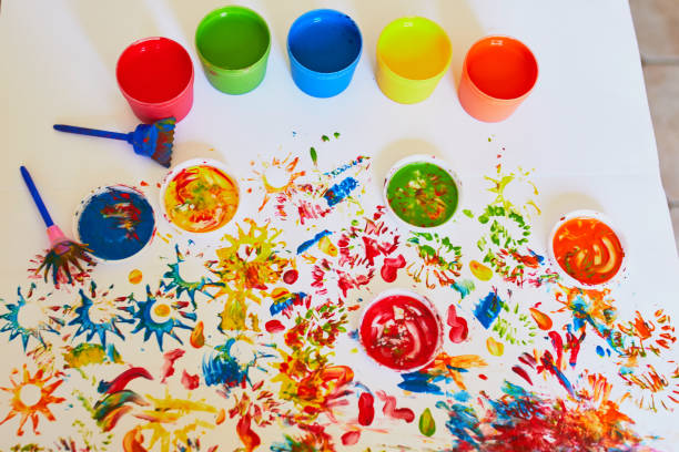Pots with colorful dye used for fingerpainting stock photo