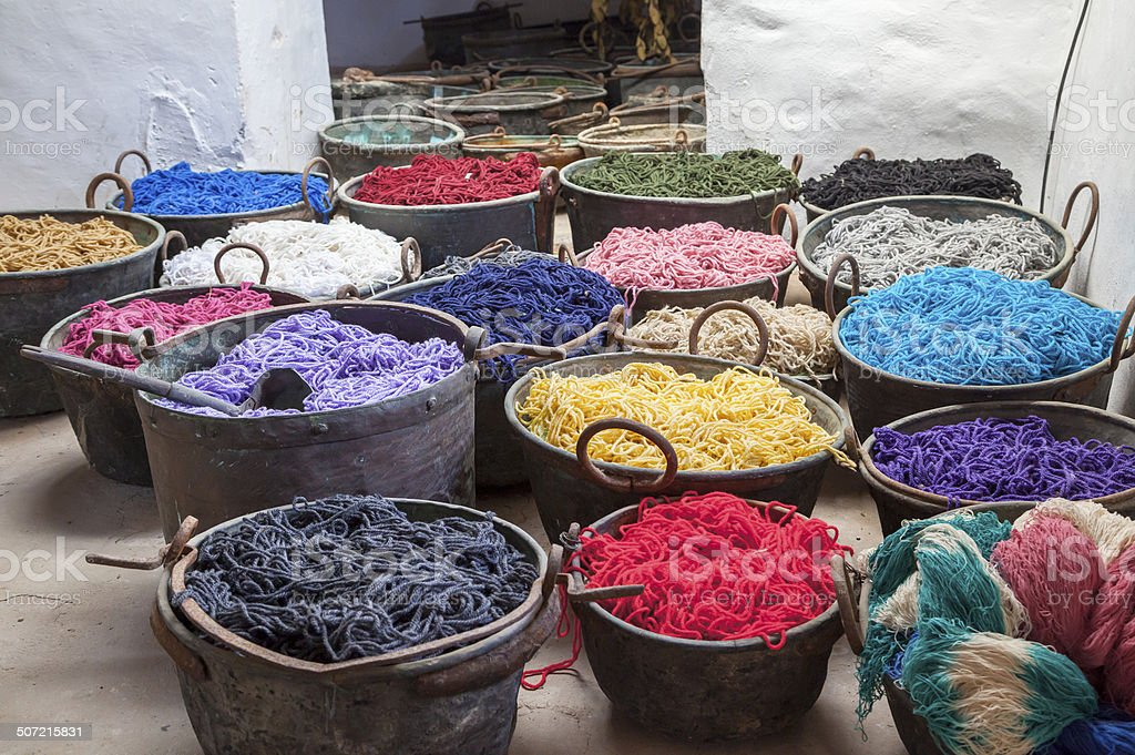 Pots with colorful yarns dyed in the old workshop, Majorca island,...