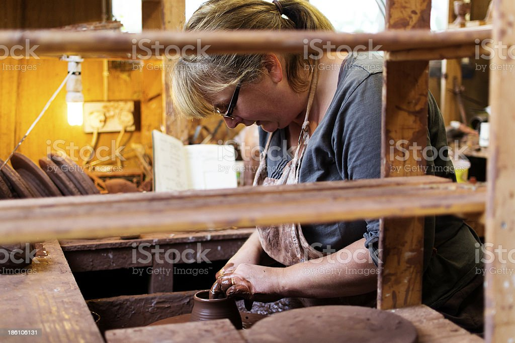 Potter at the wheel royalty-free stock photo