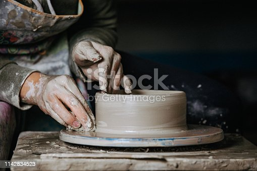 istock Potter at work 1142834523