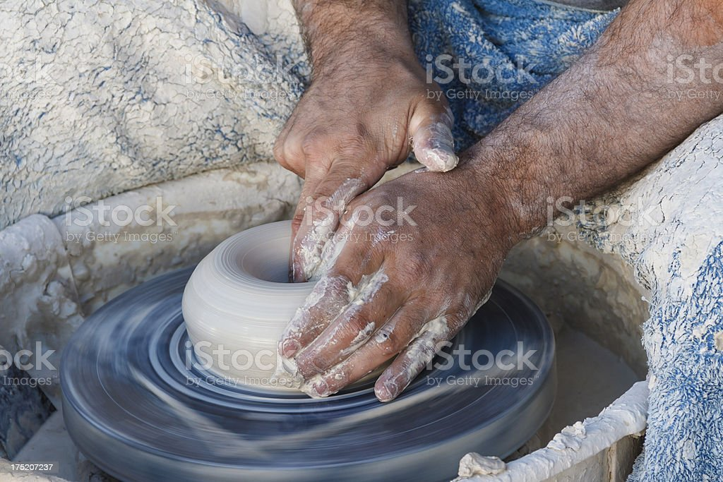 Potter Busy Making a Clay Bowl royalty-free stock photo
