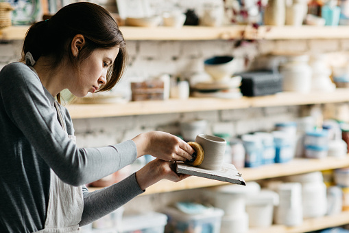 Potter creating a shape of ceramic object