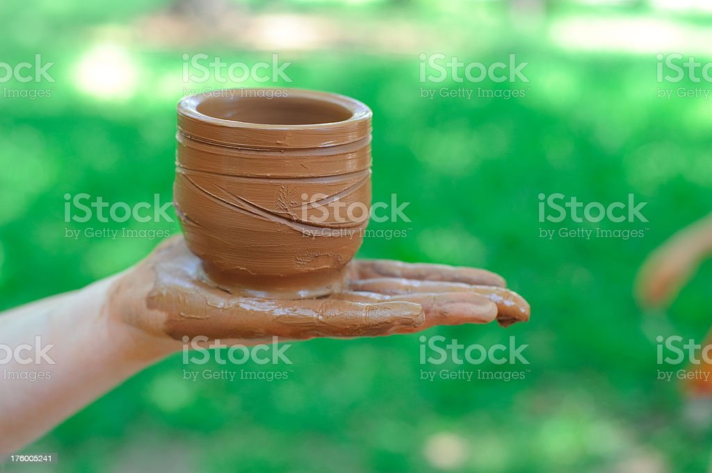 potter holds on palm just made a pitcher from clay royalty-free stock photo