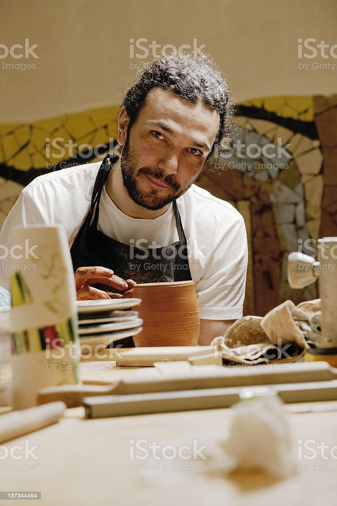 Potter in workshop royalty-free stock photo