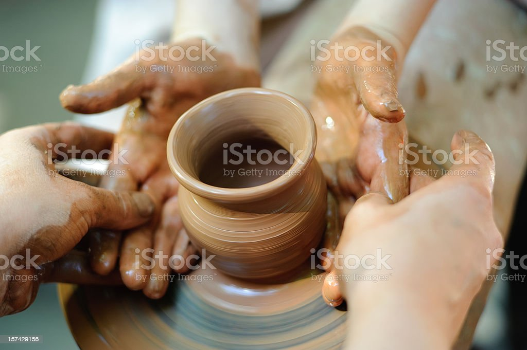 Potter making a jug out of clay on a pottery wheel stock photo