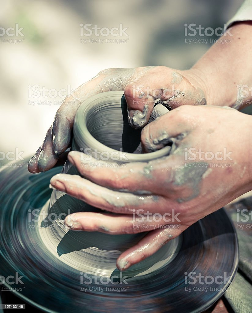 Potter making a jug out of clay royalty-free stock photo