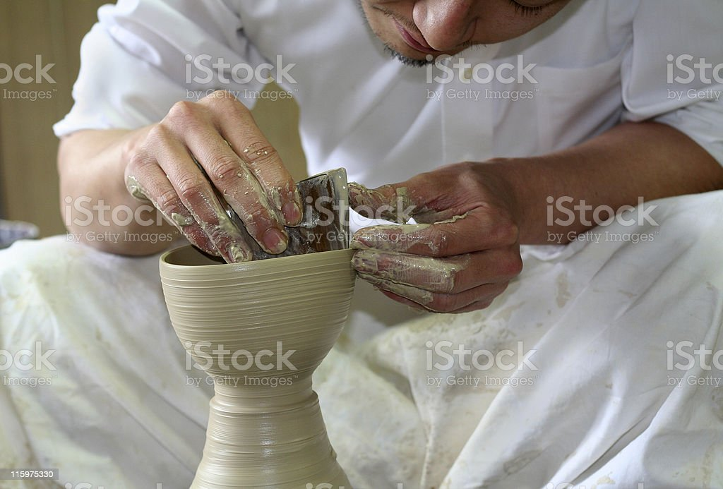 Potter shaping clay on a pottery wheel stock photo