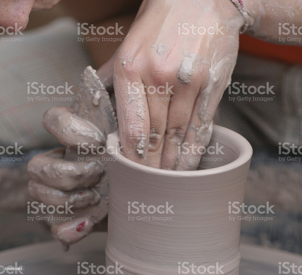 Potter With Scraping Tool royalty-free stock photo