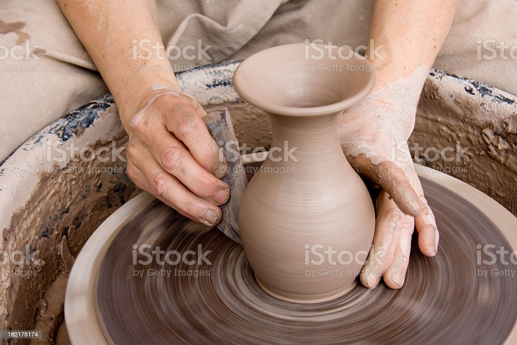 Potter With Smoothing Tool royalty-free stock photo