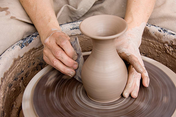 Potter With Smoothing Tool stock photo
