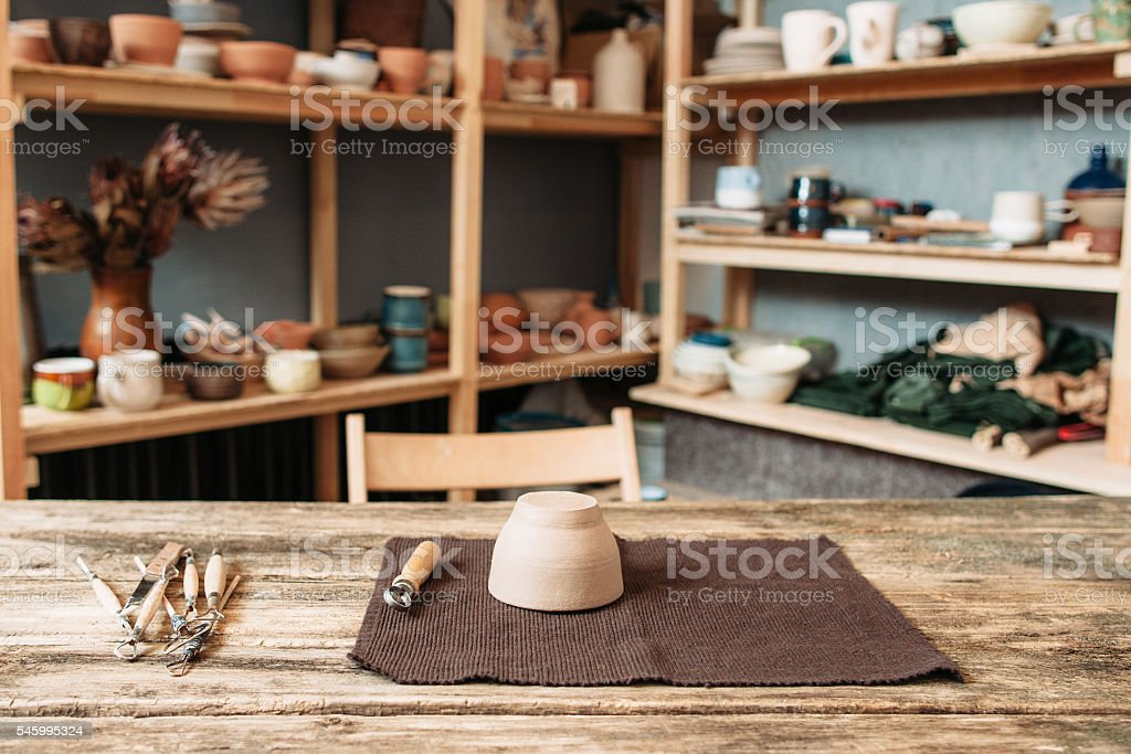 Potter workplace with necessary tools at studio stock photo