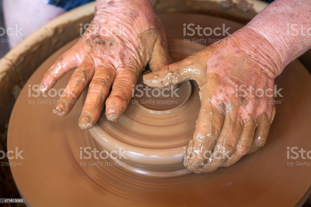 Potter works with clay in ceramics studio royalty-free stock photo
