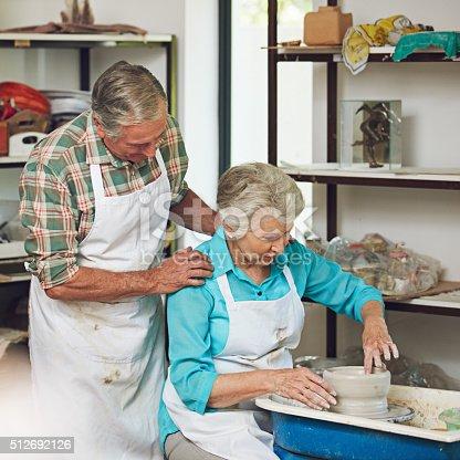 511679304istockphoto Pottering around in the workshop 512692126