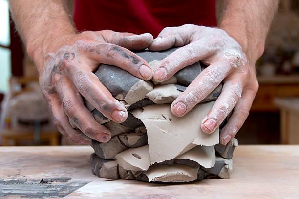 potter's hands - glasskulpturen stock-fotos und bilder