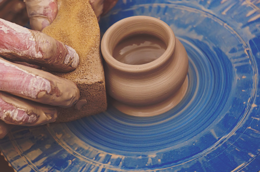 Potters hands shaping a bowl out of clay
