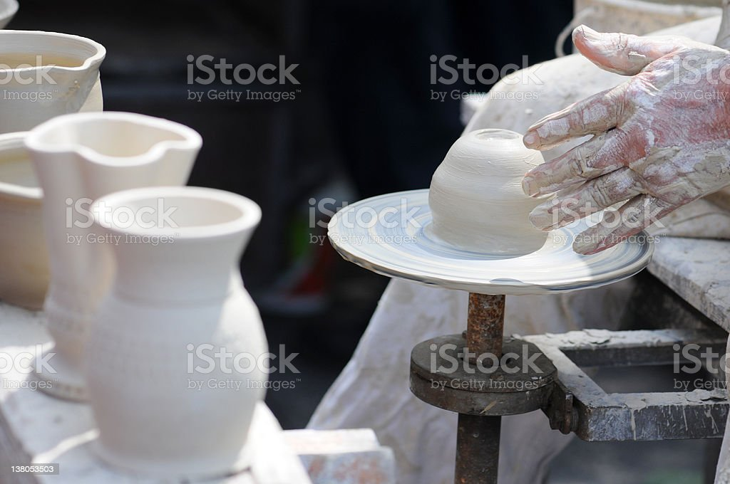 Potters Hands turning a bowl on potter wheel. royalty-free stock photo
