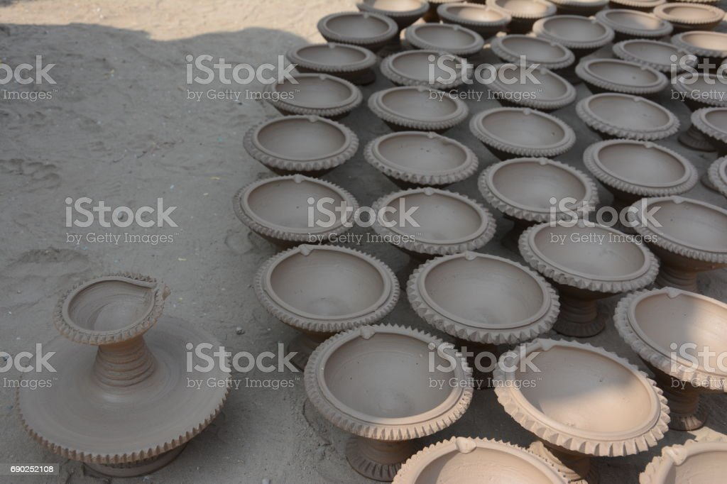 Potters struggle to keep glow of Diyas as artificial lights take over market stock photo
