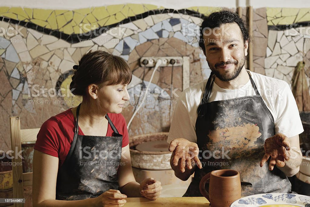 Potters with jug royalty-free stock photo