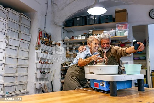 511679304istockphoto Pottery is their favorite pastime 1183931461