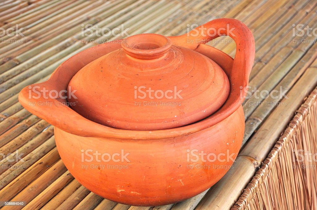 pottery on bamboo table , traditional pottery Thai kitchen stock photo