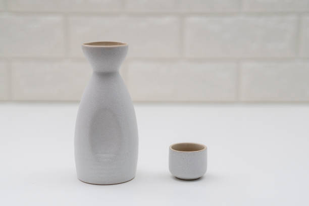 pottery sake bottle and cup, in white background