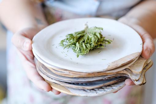 pottery skill traditional hold clay plate crockery