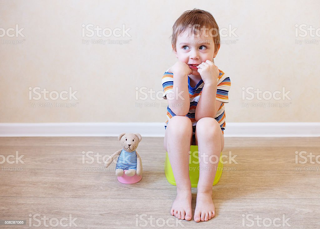 potty training toddler and teddy stock photo