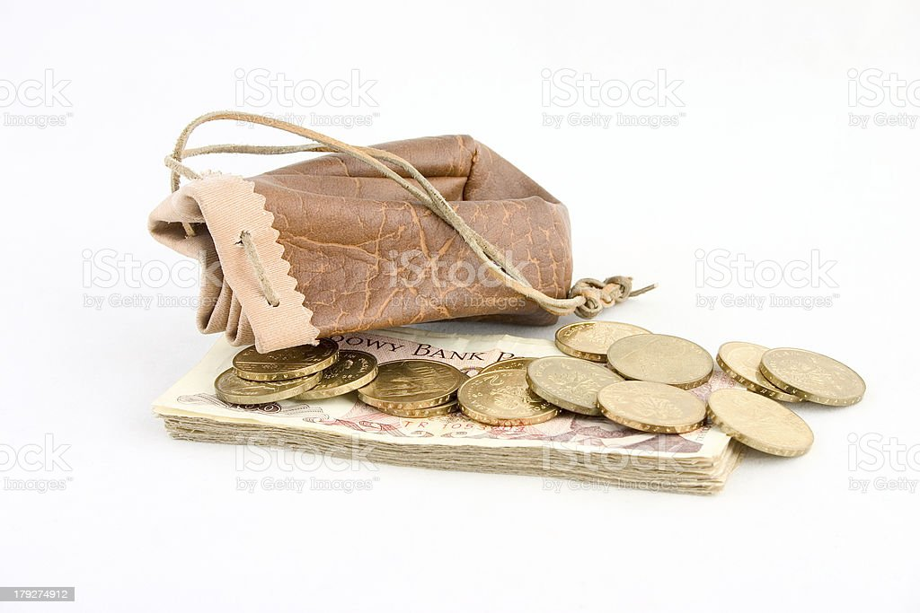 Pouch with gold coins and banknotes. royalty-free stock photo