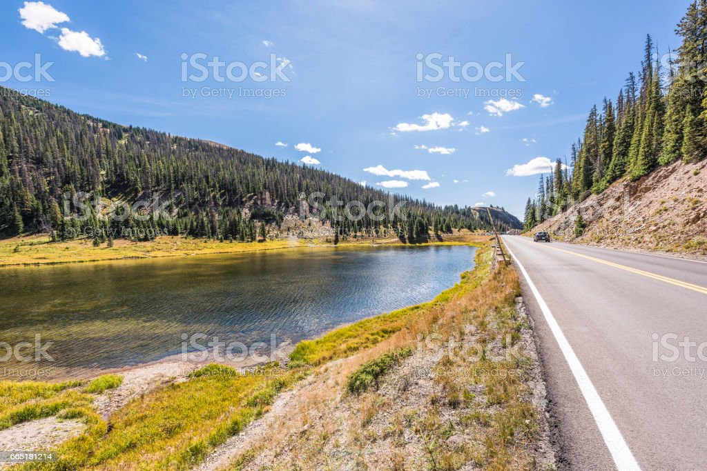 Poudre Lake in the fall in Rocky Mountains in Colorado with road stock photo