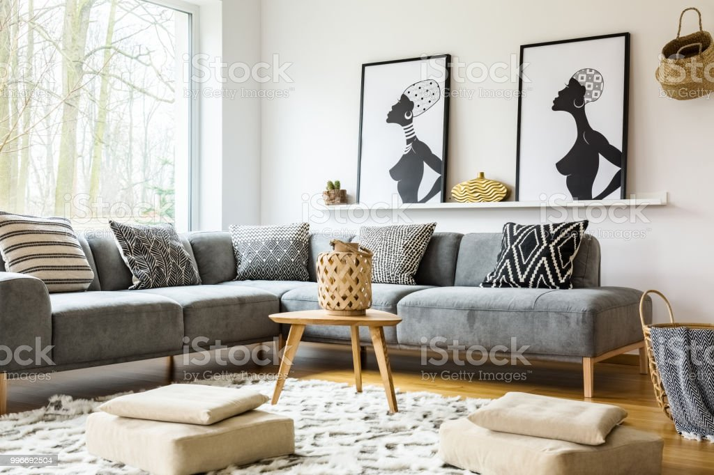 Poufs On Carpet In Bright African Living Room Interior With ...