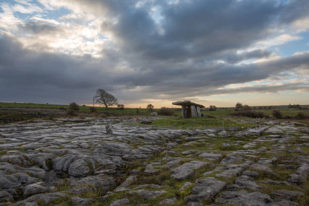 poulnabrone dolmen in the burren landscape - the burren stock pictures, royalty-free photos & images