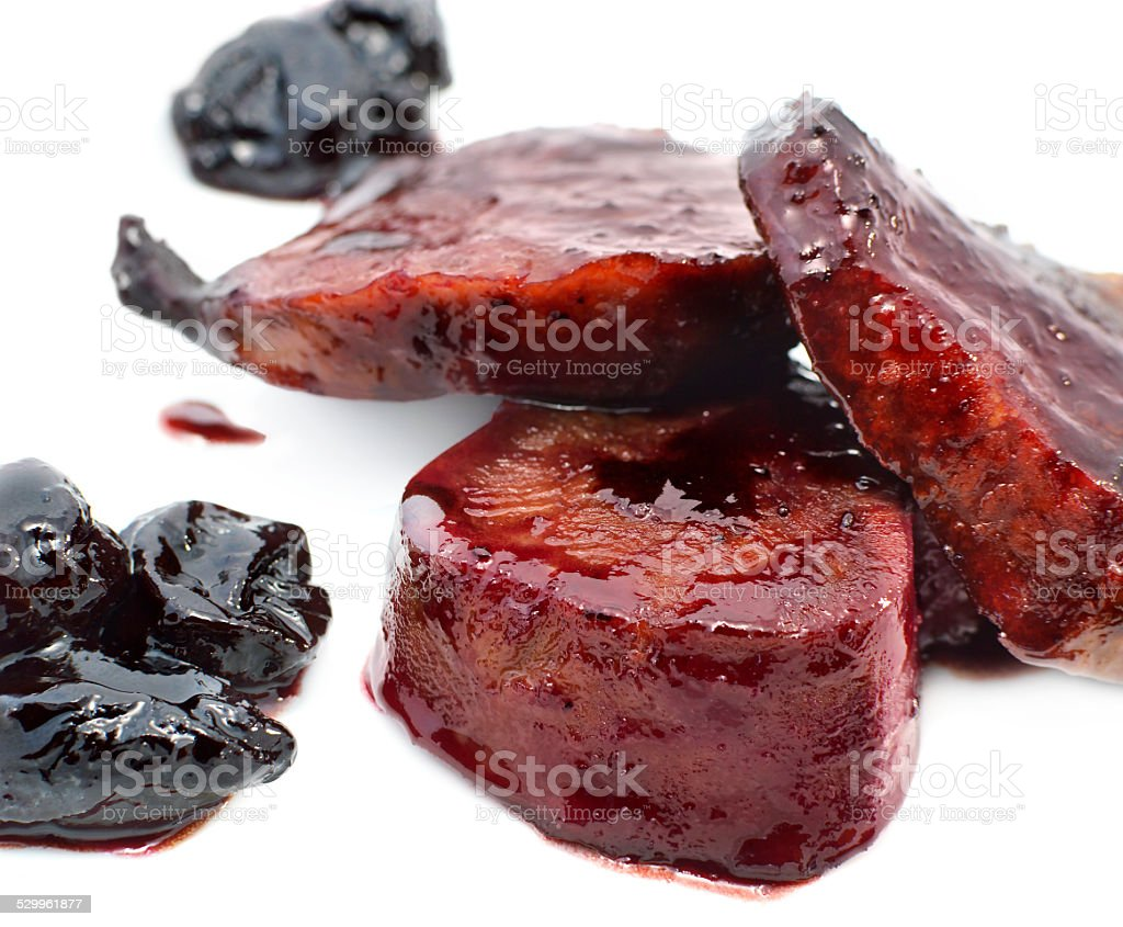 Poultry in sweet plum sauce with prunes stock photo