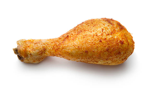 Poultry: Roast Chicken Drumstick Isolated on White Background More Photos like this here... drumstick stock pictures, royalty-free photos & images