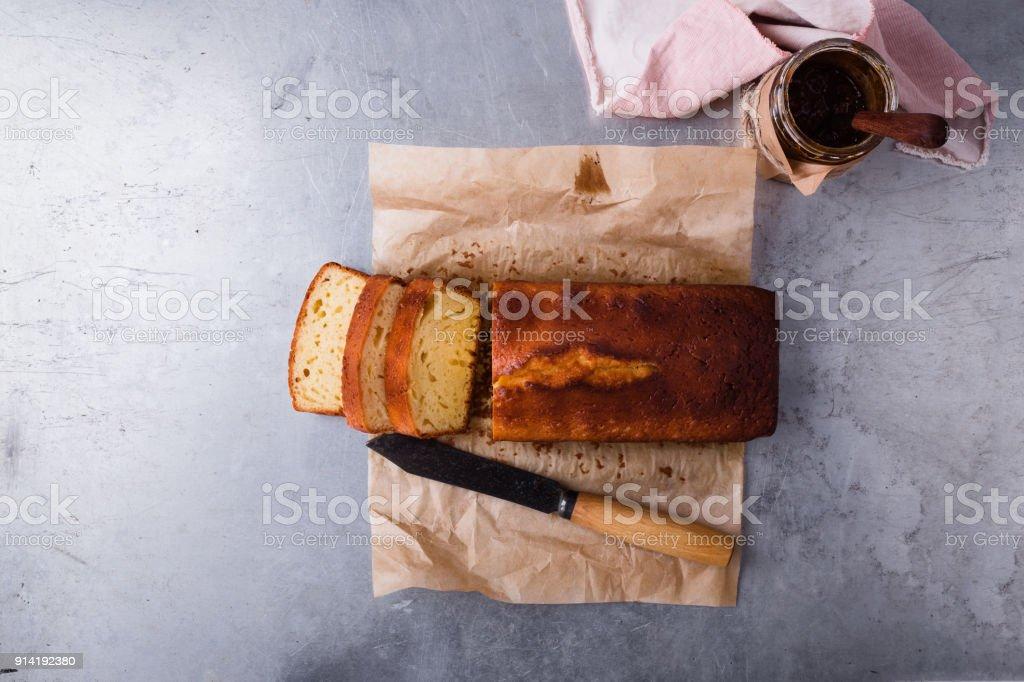 Pound cake on baking paper and fruit jam stock photo
