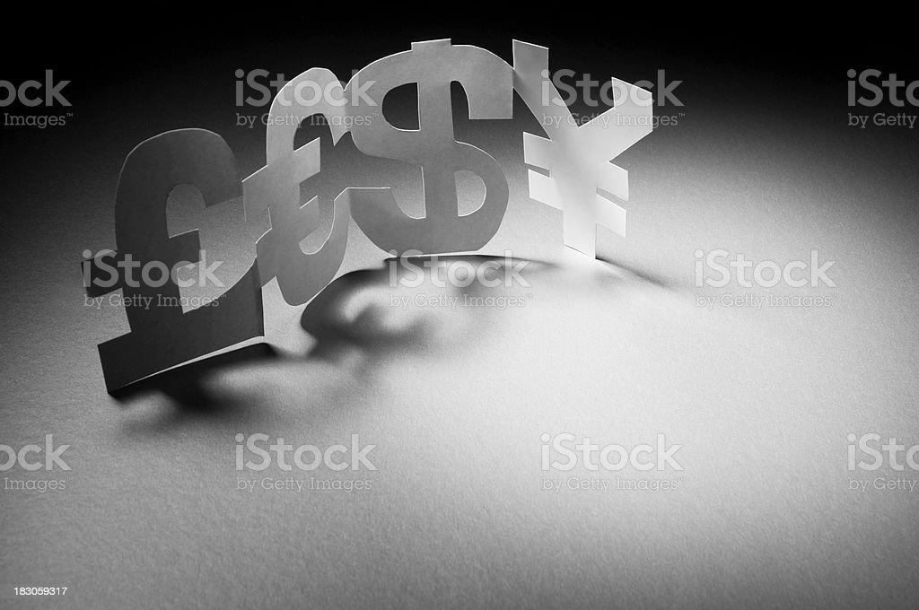 Pound, Euro, dollar and Yen symbols in spotlight royalty-free stock photo
