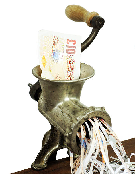 Pound note in a meat grinder SONY DSC10 pounds note in a meat mincer in a conceptual photograph money to burn stock pictures, royalty-free photos & images