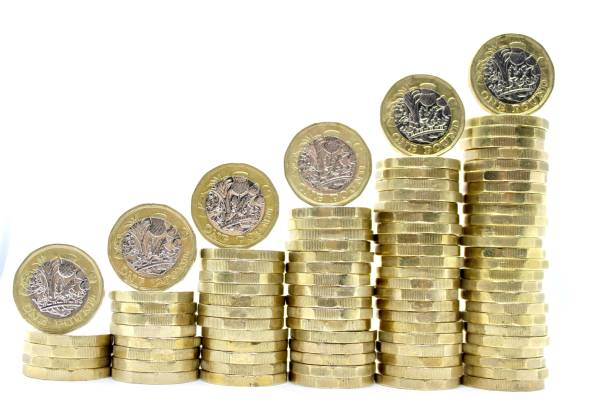 Pound Rising Stacks of ascending UK one pound coins with individual coins balanced on top. one pound coin stock pictures, royalty-free photos & images