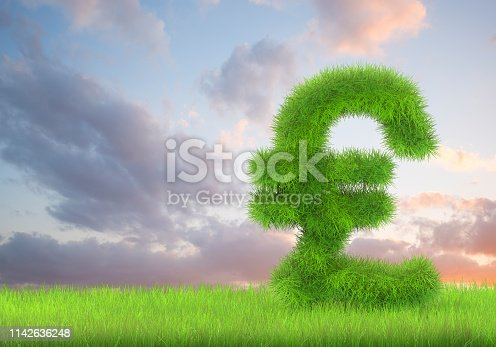 A pound sign in lush green grass on a cloudscape  background