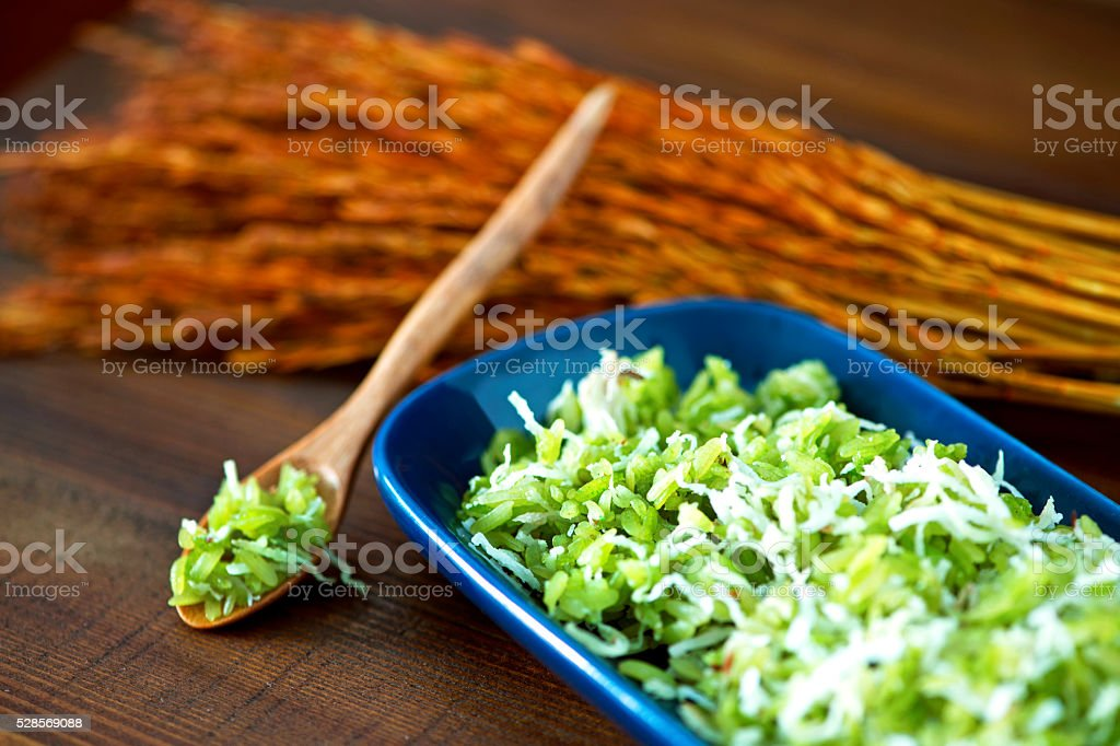Pounded unripe rice stock photo