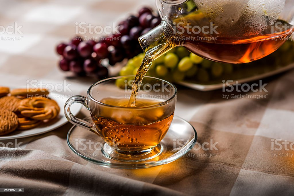 Pour a cup of tea stock photo