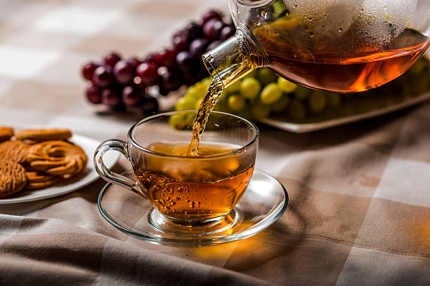 Pour a cup of tea stock photo