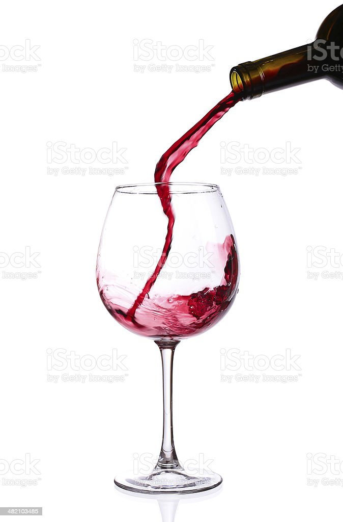 Pour a glass of wine stock photo