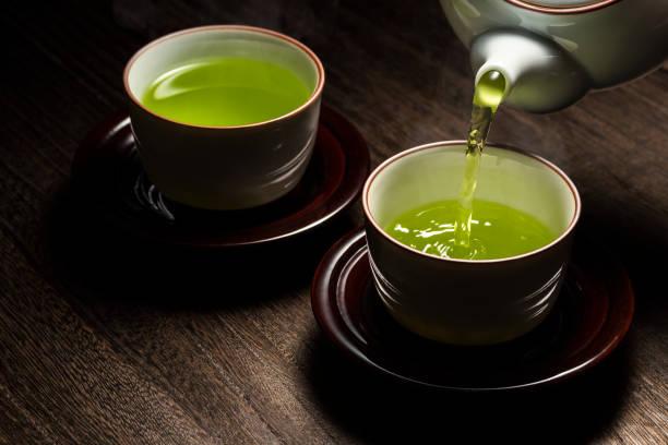 Pour green tea Pour green tea greentea stock pictures, royalty-free photos & images