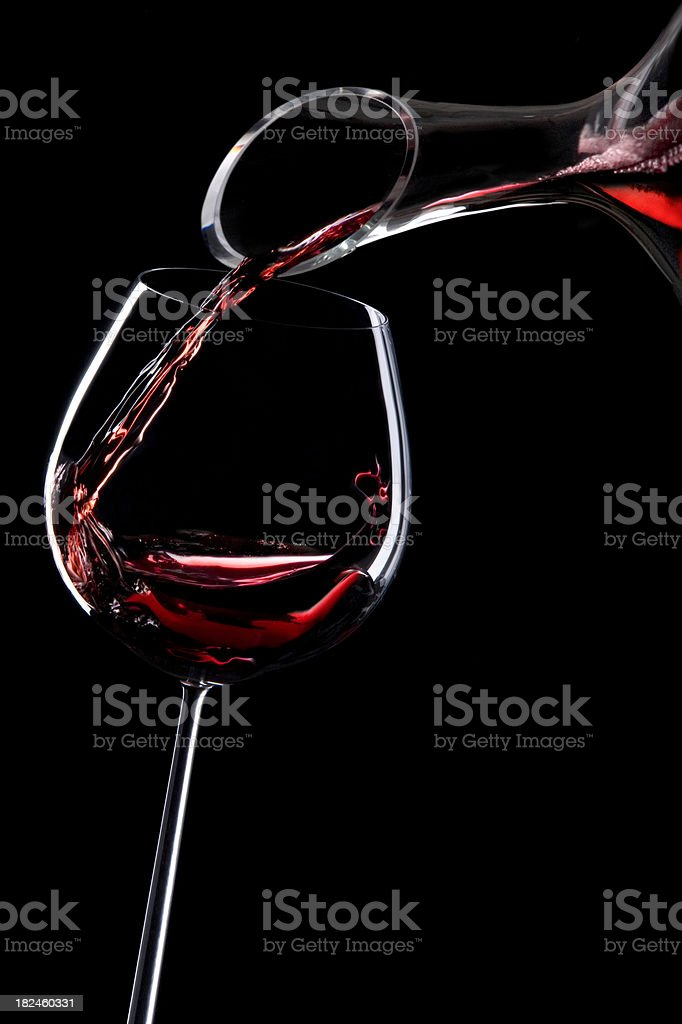 Pour red wine in a Glas stock photo