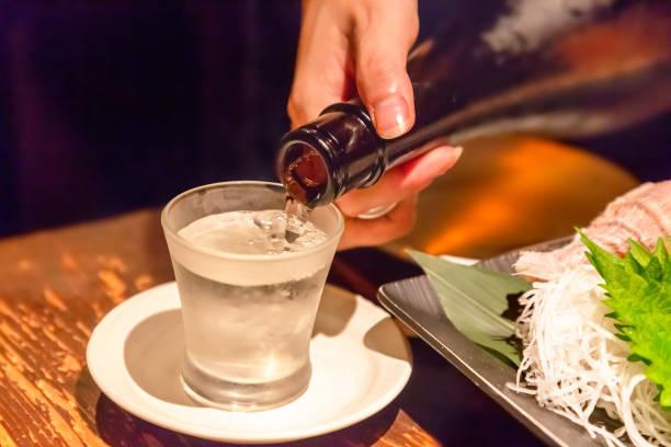 Pour the sake stock photo